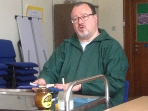 Chaim Ebanks from Exeter Bookbinders demonstrates bookbinding to the Devon SfEP group