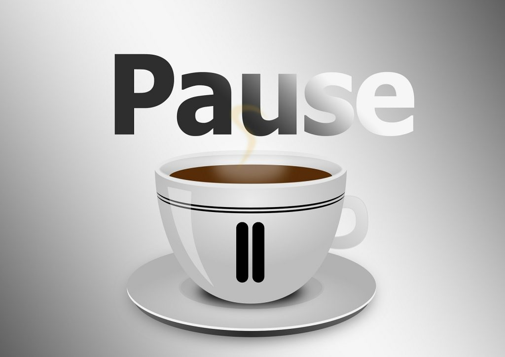 Coffee cup with pause symbol