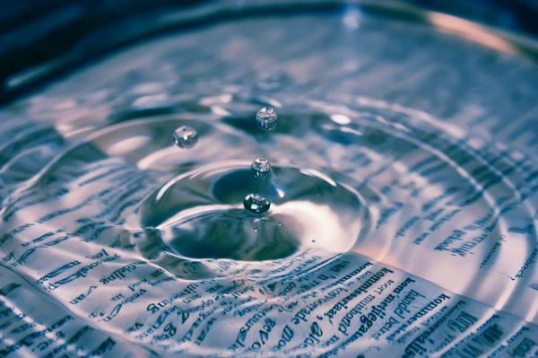 Water ripples above book pages