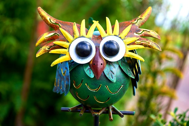Multi-coloured metal owl sculpture