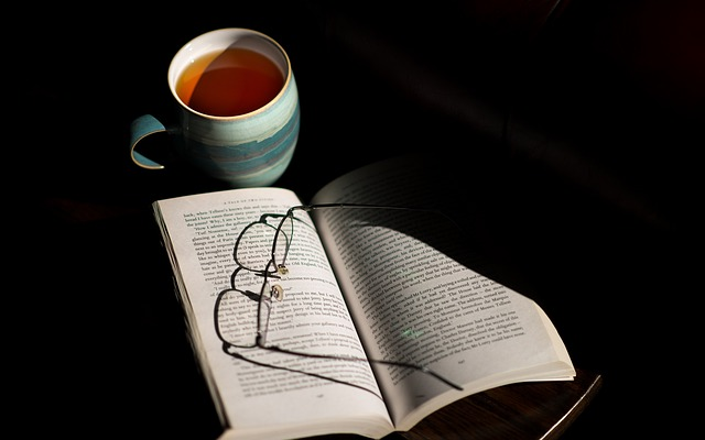 Cup of tea next to an open book
