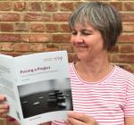 Melanie Thompson reading the SfEP guide 'Pricing a project'