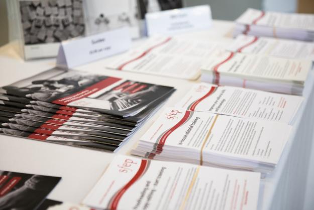 A table covered with copies of leaflets about what the SfEP does and can offer