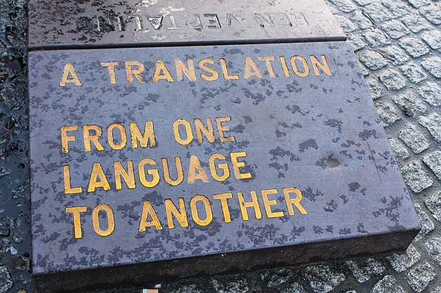 Large, flat stone with an engraving that says 'A translation from one language to another'