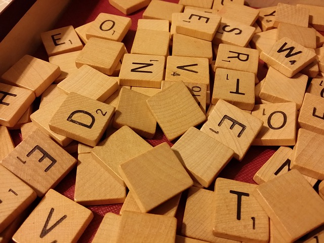 Scattered Scrabble letter tiles