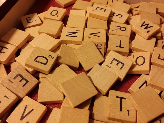 Scattered Scrabble letter tiles