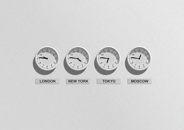 Four clocks on a wall: one showing the time in London, one New York, one Tokyo and one Moscow